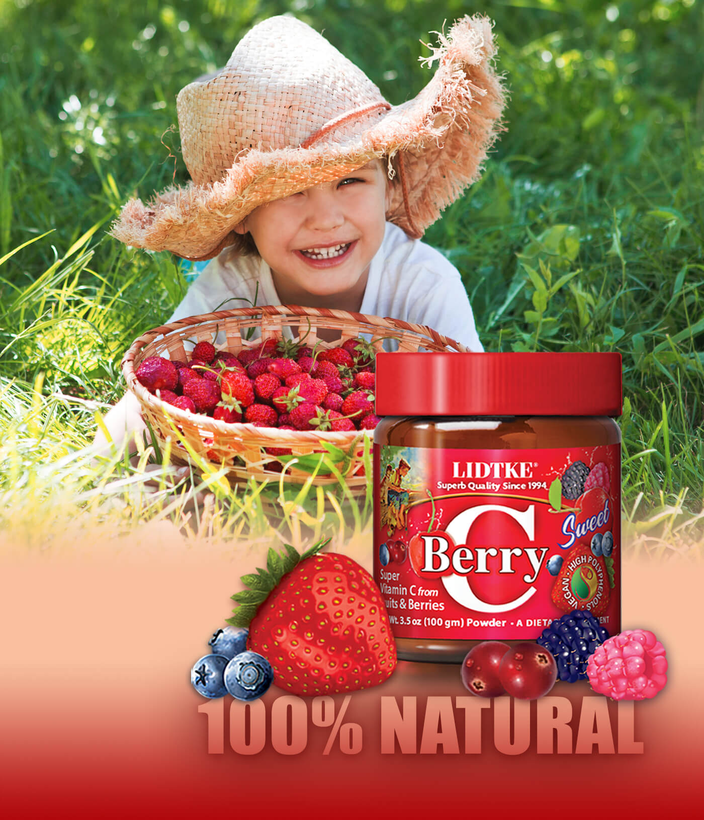 Happy child with big straw hat and basket of fresh strawberries in natural grass setting with 100% natural Berry C Sweet jar.